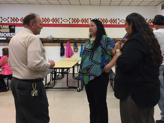 Heart Butte Superintendent Lee Foley speaks with parent, grandparent and teacher Crystal Tailfeathers after the Heart Butte public meeting on Tuesday, Sept. 26.