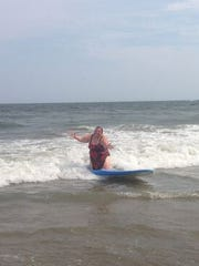 Jen tries out surfing for the first time in Belmar.