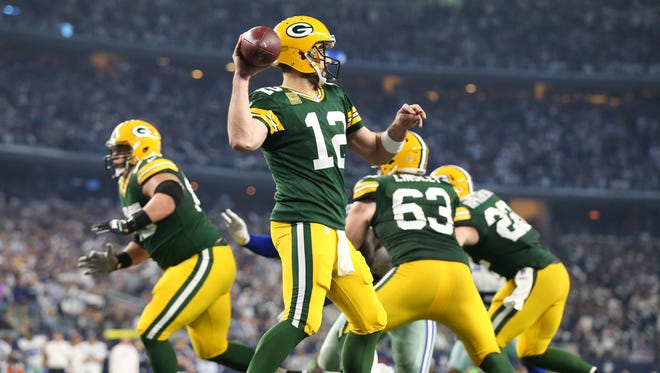 Packers QB Aaron Rodgers (12) carved up the Cowboys on Sunday.