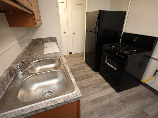 A new kitchen in one of the renovated apartments at