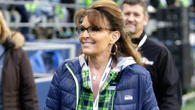 Former Alaska governor Sarah Palin is pictured walking on the sideline before an NFL football game between the Seattle Seahawks and the Los Angeles Rams in Seattle.