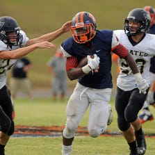 Escambia's Terik Miller runs down field with Vidor Pirates Justin Kaiser (24) and Jacob Ernst chasing him Saturday.