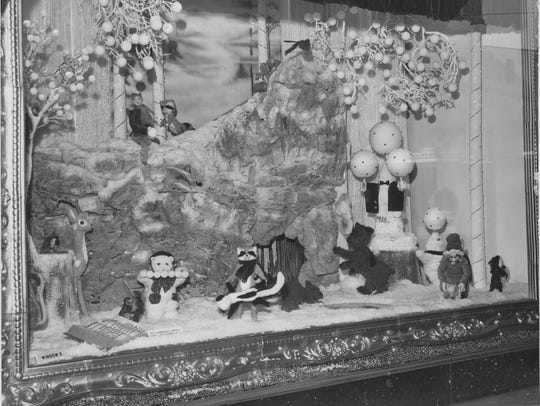 Christmas window at William H. Block featured woodland