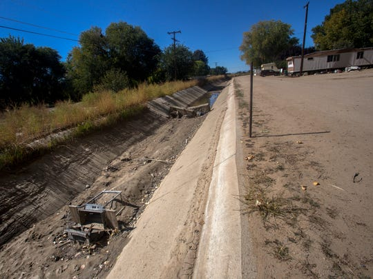 A portion of the Farmers Mutual Ditch running through Kirtland is seen here on Friday.