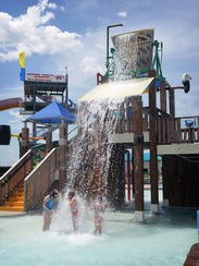 In this file photo, children in the Buccaneer Bay section of Castaway Cove Waterpark gather to stand under the giant bucket waterfall