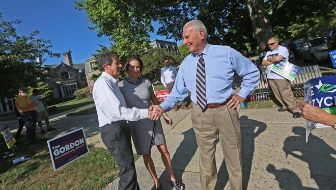 Wilmington mayor candidate Mike Purzycki greets Hank Gallagher at Immanuel Church on Election Day Tuesday.