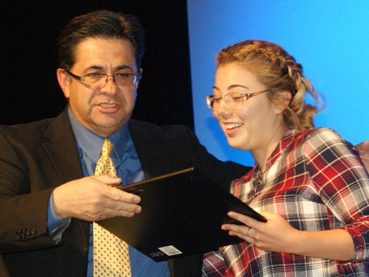 Deming High alumnus Jimmy Herrera presents the Rachel