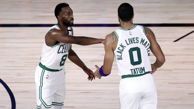 Boston Celtics guard Kemba Walker (8) and forward Jayson Tatum (0) react during the third quarter against the Philadelphia 76ers in Game 4 of an NBA basketball first-round playoff series, Sunday, Aug. 23, 2020, in Lake Buena Vista, Fla.