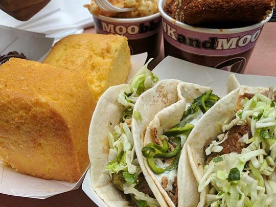 Oink and Moo BBQ tacos are served with fresh cornbread and mac and cheese.