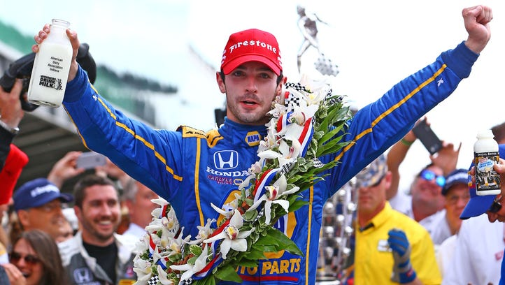 Alexander Rossi celebrates after winning the 100th