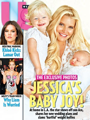 Jessica Simpson poses with daughter Maxwell and baby son, Ace, for Us Weekly.