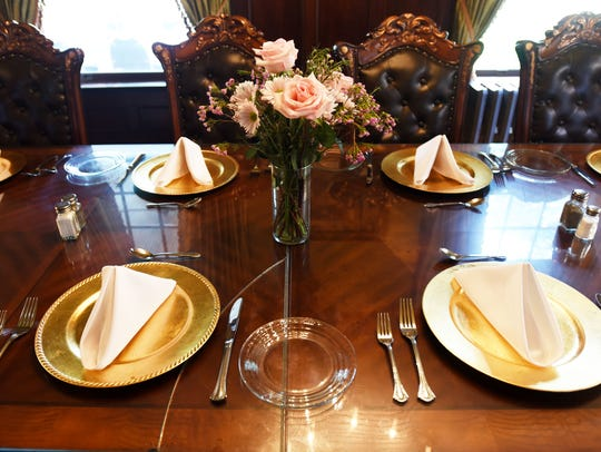 Place settings on Grace Estate formal dining room.