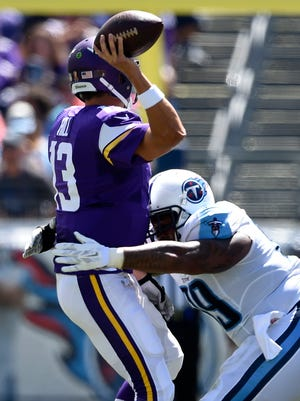 Titans defensive end Jurrell Casey (99) closes in on Vikings quarterback Shaun Hill (13) in the first half Sunday.