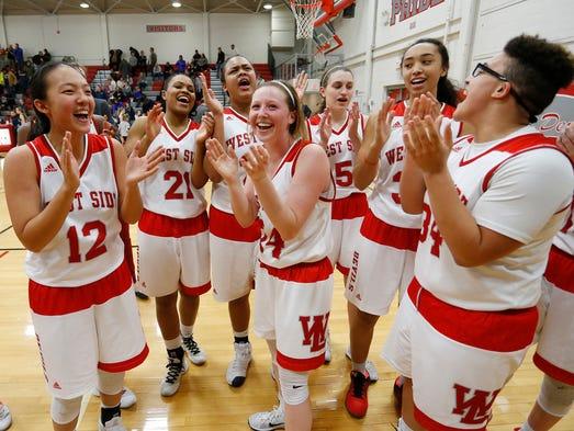 West Lafayette players celebrate after Allie Jin, far