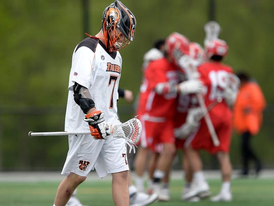 RIT's Kyle Killen walks off the field as Wesleyan University