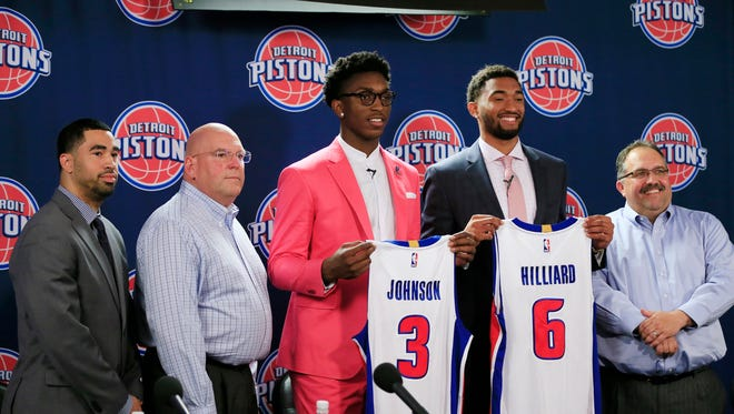 The Detroit Pistons new draft picks, Darrun Hilliard, (6) and Stanley Johnson stand with, from left, Assistant GM Brian Wright, GM Jeff Bower, and Pistons head coach and president Stan Van Gundy, right, at a news conference, Saturday, June 27, 2015.