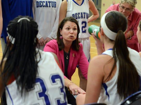 Decatur head coach Amy Mergott rallies her troops during