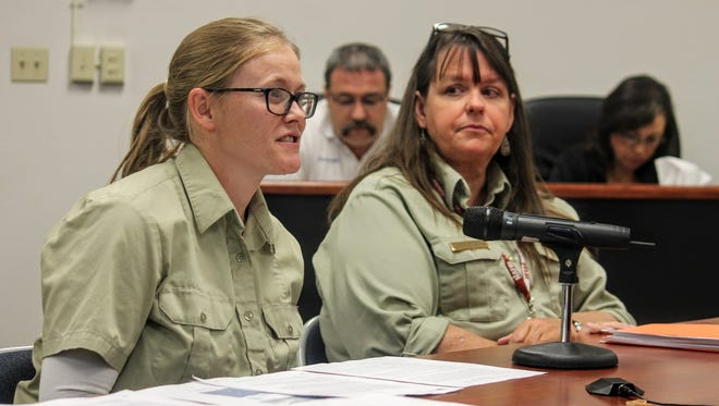 National Environmental Policy Act (NEPA) Planner for the Sacramento District Ciara Cusack (left) and Sacramento District Ranger Elizabeth Humphrey (right) discuss the Rio Peñasco wetland project at special county commission meeting Monday.