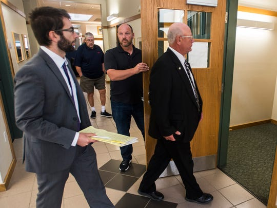 Former lawmaker Norm McAllister enters Vermont Superior Court in St. Albans on Friday morning, July 14, 2017, for the third day of his trial.