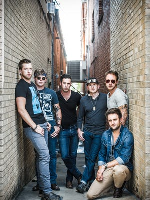 Backroad Anthem singer Craig Strickland, third from left, was killed in a weather-related accident while duck hunting in December.