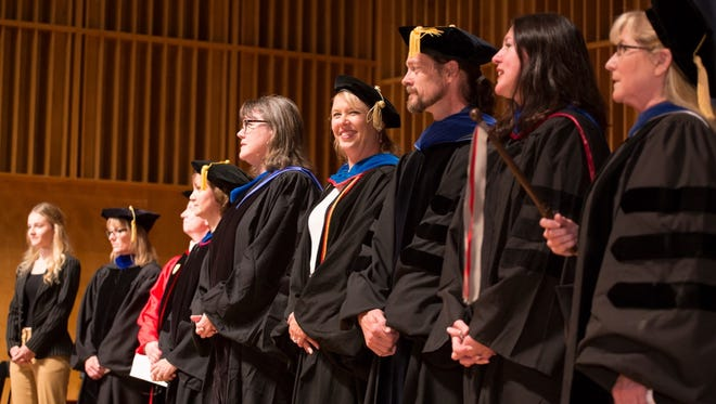 Dr. Elizabeth Nichols (center) was one of five Drury professors honored with the 2016 Faculty Awards. Karen Spence, Erin Kenny (on her left), Kristofor Wiley and Natalie Wlodarczyk (on her right) were the others.