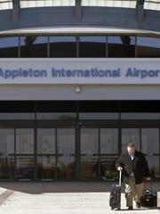 A passenger leaves the Appleton International Airport