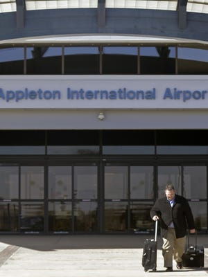 A passenger leaves the Appleton International Airport in Greenville. Passengers increased by nearly 5 percent in 2017.