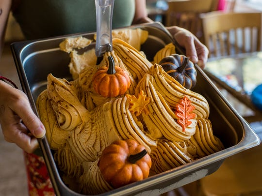 Co-owner Silvia Bertolazzi holds a tray of her Speciale gelato, a pumpkin spice flavored dessert, at Carpe Diem! Espresso and Gelato in downtown Lafayette, La., Wednesday, Sept. 23, 2015.