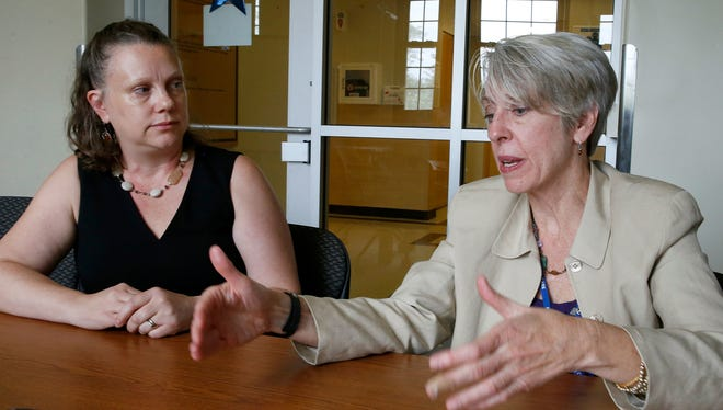 Susan Strickland, acting director of the Veterans Health Administration's Veterans Crisis Line, right, talks during an interview June 13, 2017, in Canandaigua, N.Y. Julianne Mullane, assistant deputy director of team operations for the Canandaigua branch of the Veterans Crisis Line, is at left.