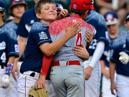 Red Land's Dylan Rodenhaber hugs Japan shortstop Yugo Aoki after Japan won the Little League World Series Championship game 18-11, Sunday August 30, 2015. John A. Pavoncello -jpavoncello@yorkdispatch.com