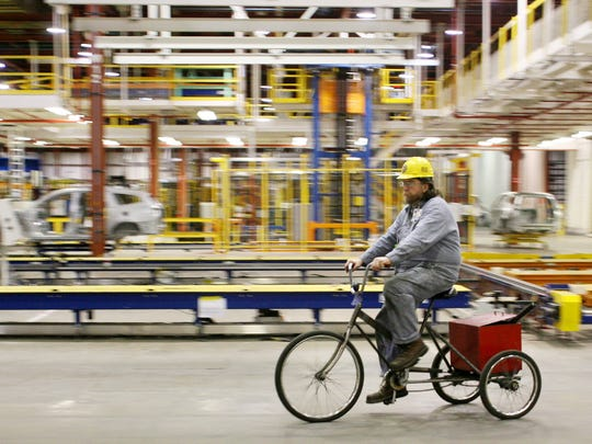 A worker cycles through the body shop area at the GM Spring Hill plant March 10, 2008.