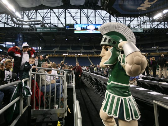 Michigan State mascot Sparty entertains the  fans as