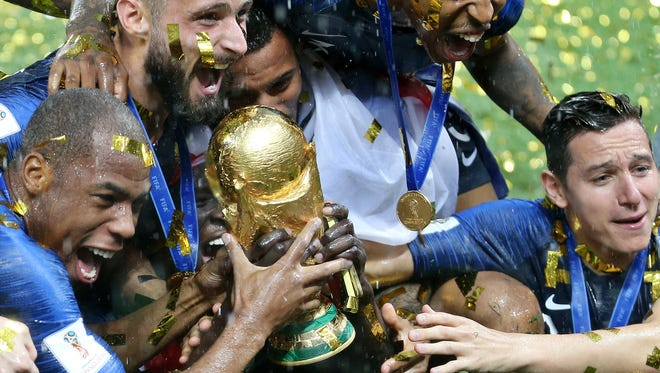 France celebrated winning the World Cup. The tournament will be played in the U.S., as well as Mexico and Canada, in eight years.