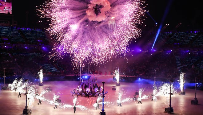 Fireworks explode during the Winter Olympics opening ceremony.