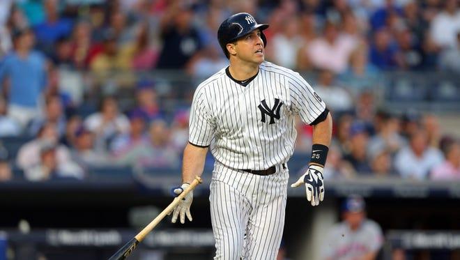 Mark Teixeira hits a three-run home run during the second inning.