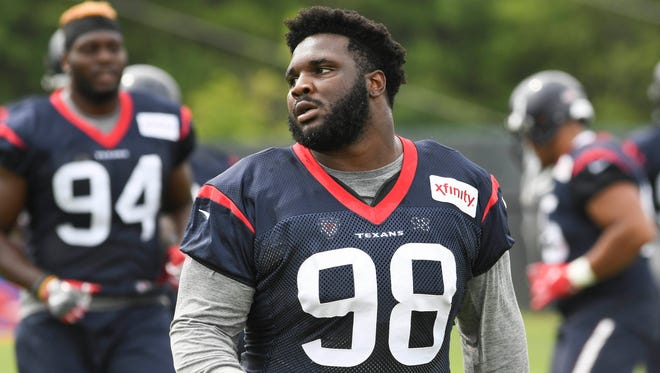 Jul 27, 2017; Greenbrier, WV, USA; Houston Texans nose tackle D.J. Reader (98) stretches during training camp at The Greenbrier.