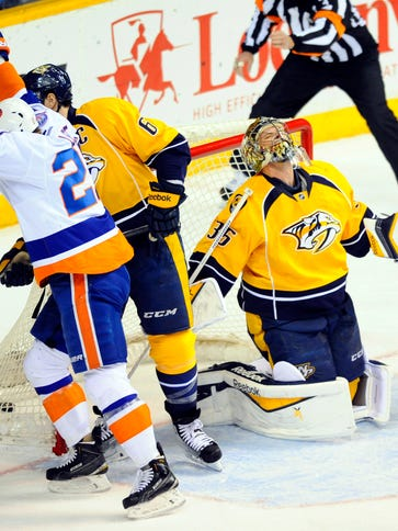 Nashville Predators goalie Pekka Rinne reacts after