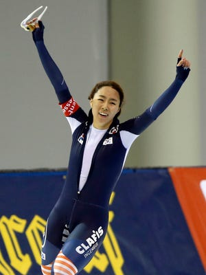 Lee Sang-Hwa celebrates her world record in the 500 meters.