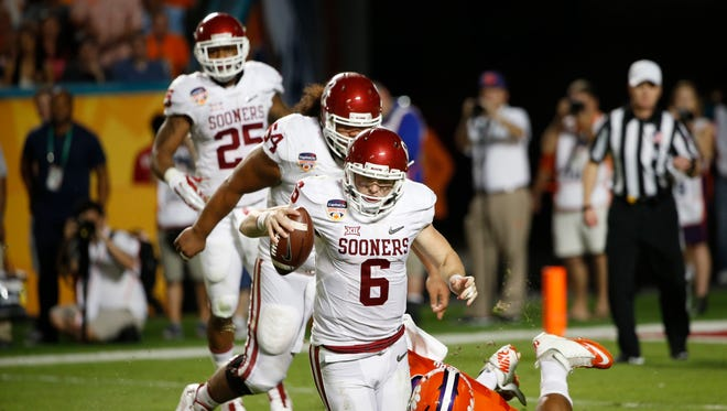 Clemson defensive end Kevin Dodd sacks Oklahoma quarterback Baker Mayfield in the third quarter.