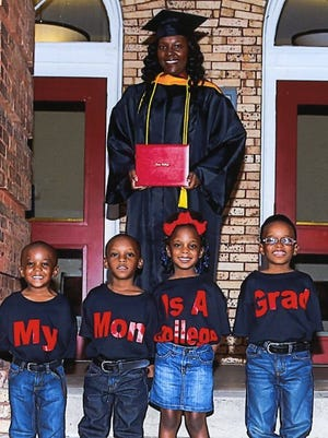 Tambra Brice stands with her four children, Major, Tylan, Taleiyah and Coreion. Brice, a single mother, will graduate from Lane College on Saturday.