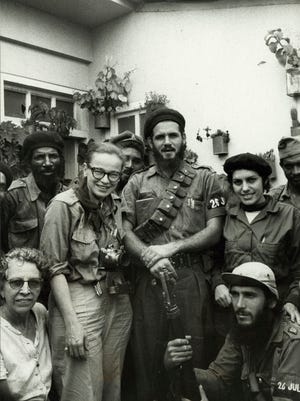 War photographer and Shorewood native Dickey Chapelle poses with Maj. Antonio Lusson and a group of soldiers during the Cuban Revolution in this 1958 photo.
