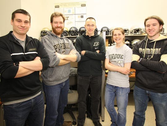 Eric Nauman, center, a Purdue mechanical engineering