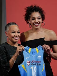 Connecticut's Gabby Williams, right, poses for a photo