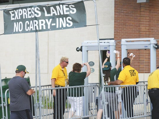 Fans make their way through metal detectors as they enter Lambeau Field for the pre-season game against the Oakland Raiders. Aug. 18, 2016.