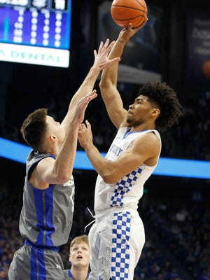 Kentucky Wildcats forward Nick Richards (4) shoots the ball as Fort Wayne Mastodons guard John Konchar (55) defends in the first half at Rupp Arena. Mandatory Credit: Mark Zerof-USA TODAY Sports