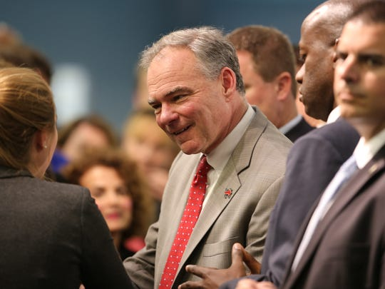 Following speaking to an invited group of people at Focus Hope in Detroit vice presidential candidate Senator Tim Kaine pauses with supporters for photographs Tuesday, Oct. 18, 2016.