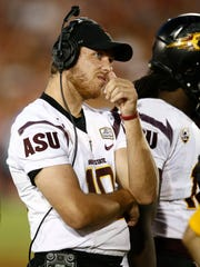 Arizona State QB Taylor Kelly watches from the sidelines against USC on Saturday, Oct. 4, 2014 at Memorial Coliseum in Los Angeles, CA.