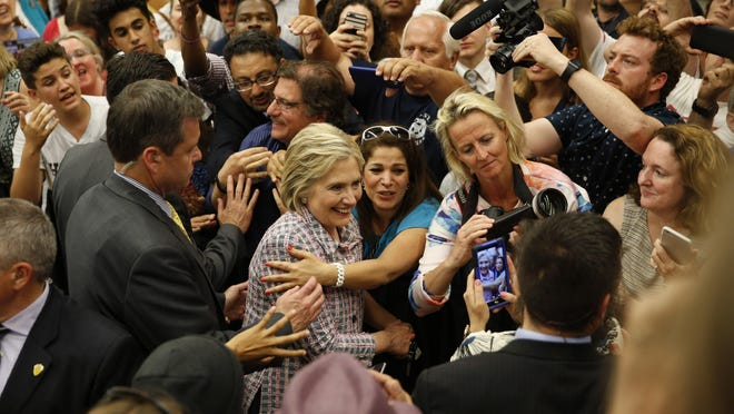 Democratic presidential candidate Hillary Clinton meets with supporters at a rally at Sacramento City College, Sunday in Sacramento, Calif.