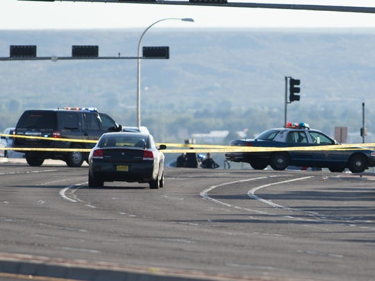 Crime scene tape prevents traffic from entering the Lohman Avenue bridge over Interstate 25 on Sunday, Aug. 21, 2016, while Las Cruces Police Department officers investigate an officer-involved fatal shooting.