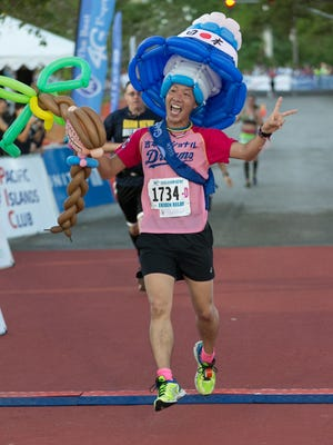 In this file photo, a runner crosses the finish line at the 10th Annual Guam Ko'ko' Half-Marathon and Ekiden Relay.